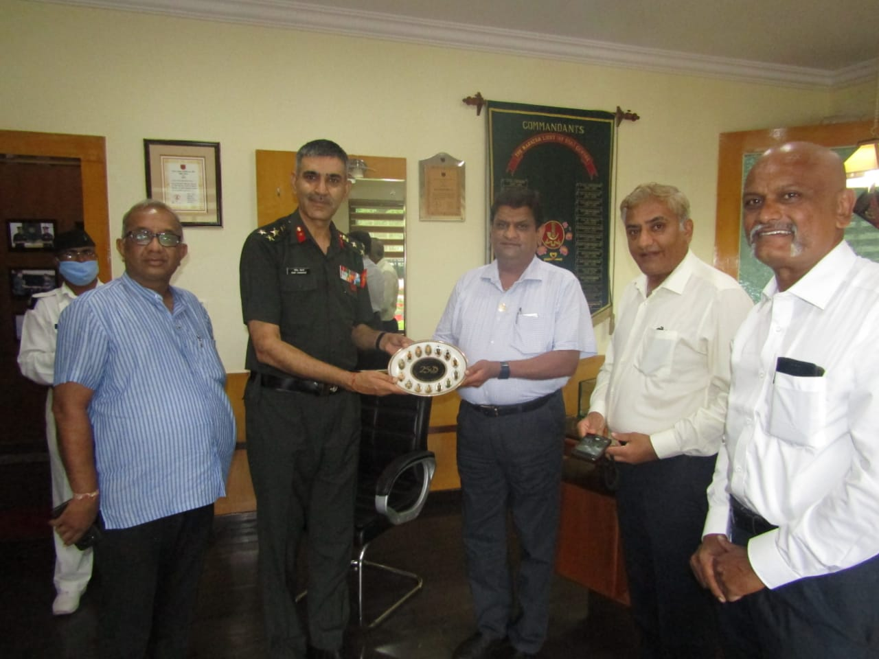 Handling of 2500 to Brigrader Rohit Choudary MLIRC for the Jawans at Belgaum Regiment Centre.